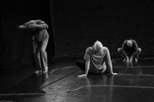 3 men dancing on stage.