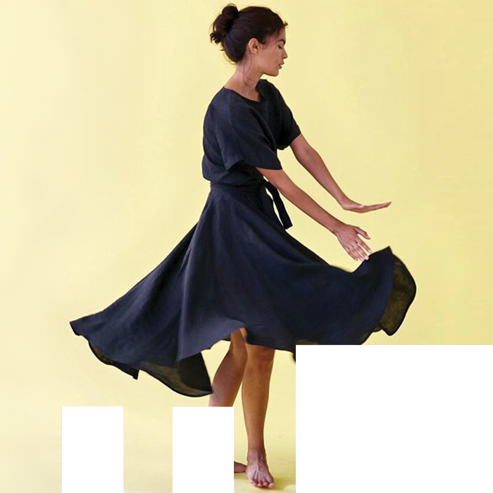 A dancers with skirt in motion as she performs.