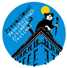 Precarious festival logo. A large rat sits on the rooftop of a building.