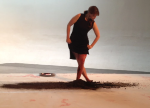 Photo of Brandy Leary dancing in the sand
