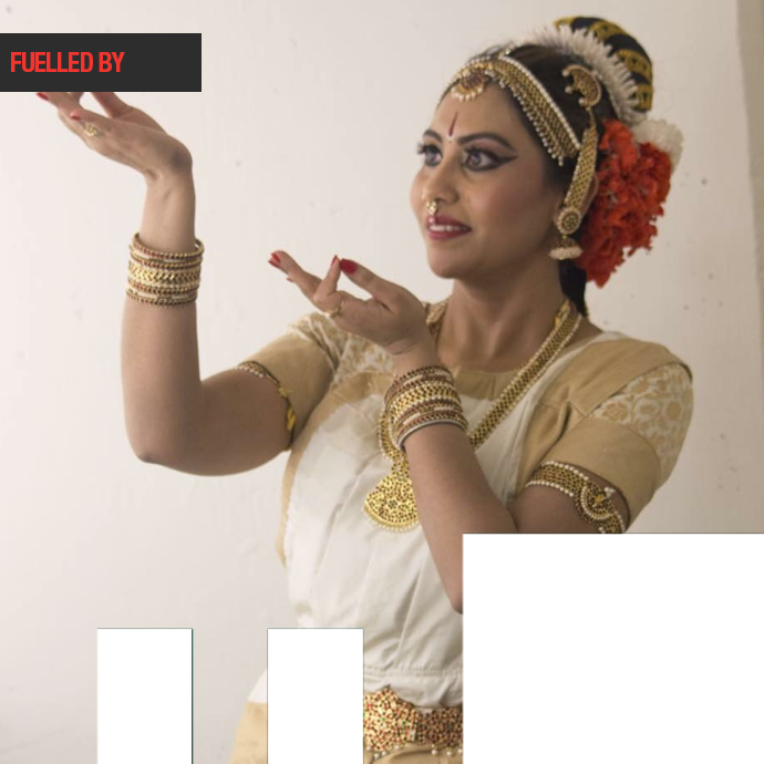 A woman performs Indian Dancing