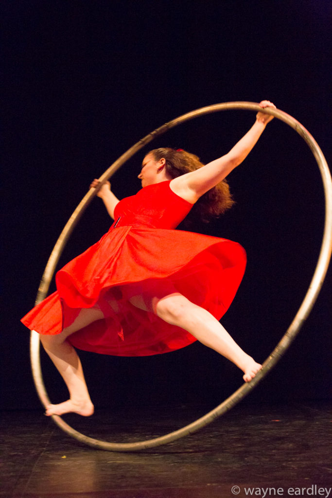 """Selah"" Opening performance, pictured is Sela Bishop on the inside of a hoop as it spins."
