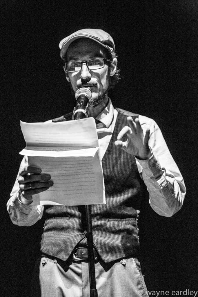 """this poem is not a dance"", pictured is Wes Ryan, In Greyscale."