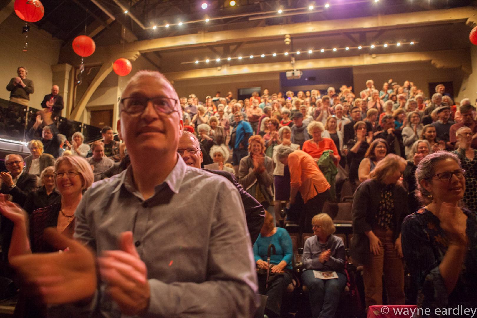An audience applauds. Photo credit to Wayne Eardley
