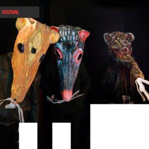 Three people wear decorative paper mache rat masks
