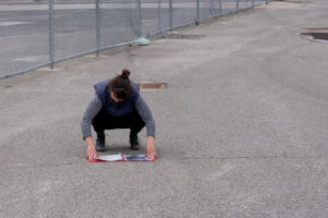 Anne White crouching.