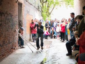 Wes Ryan performing in an alley