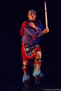 Photo of Nimkii Osawamick dancing