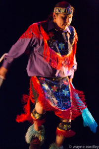 Photo of Nimkii Osawamick dancing
