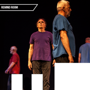 Three men, all over 50, perform onstage in brightly coloured T-shirts