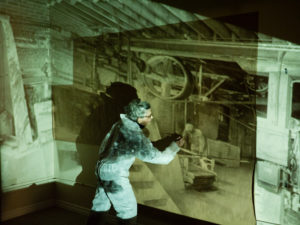 Annie Jaeger interacts with projection during installation presentation.