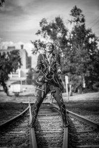 Bill Coleman performing on train tracks.