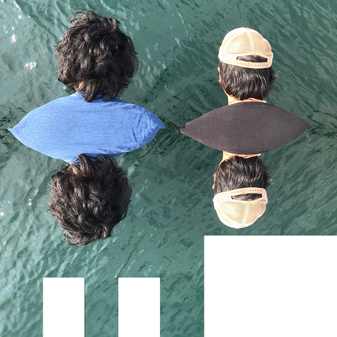 Coman Poon and Naishi Wang shown from behind over water.