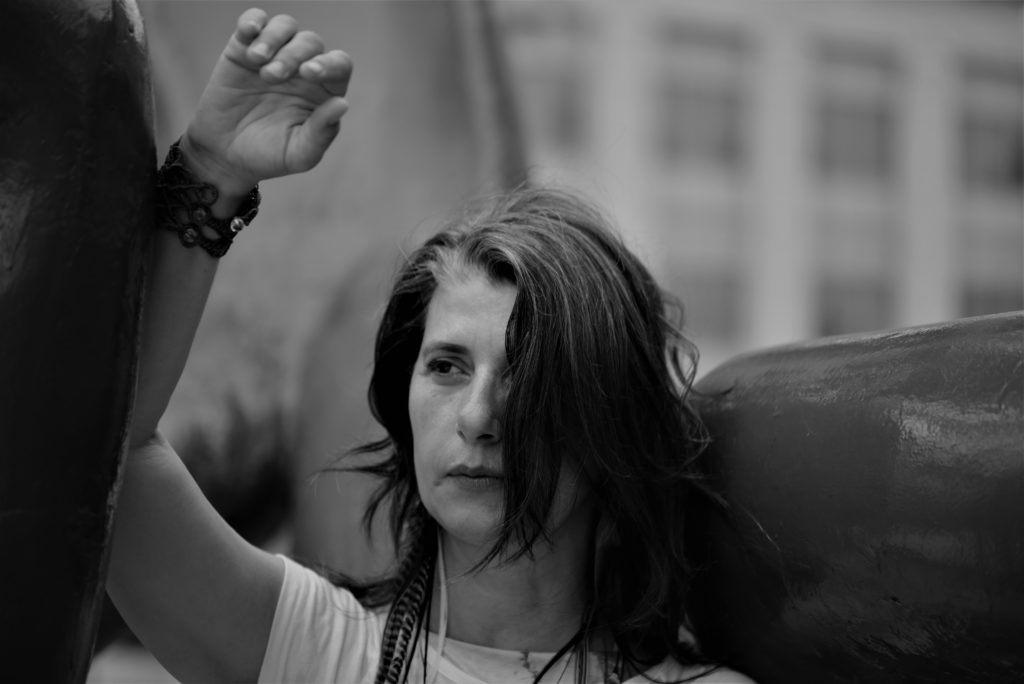 Ireni Stamou dancing with hand above their head.