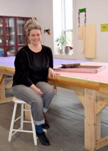 photo of Leslie Menagh in an art studio
