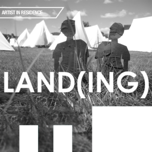 "Black and white image of paper figures and tents with text ""LAND(ING)"""
