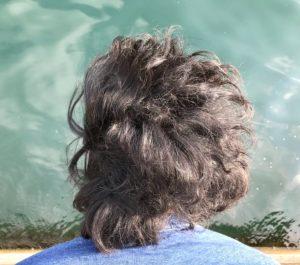Photo from behind of Naishi Wang over water