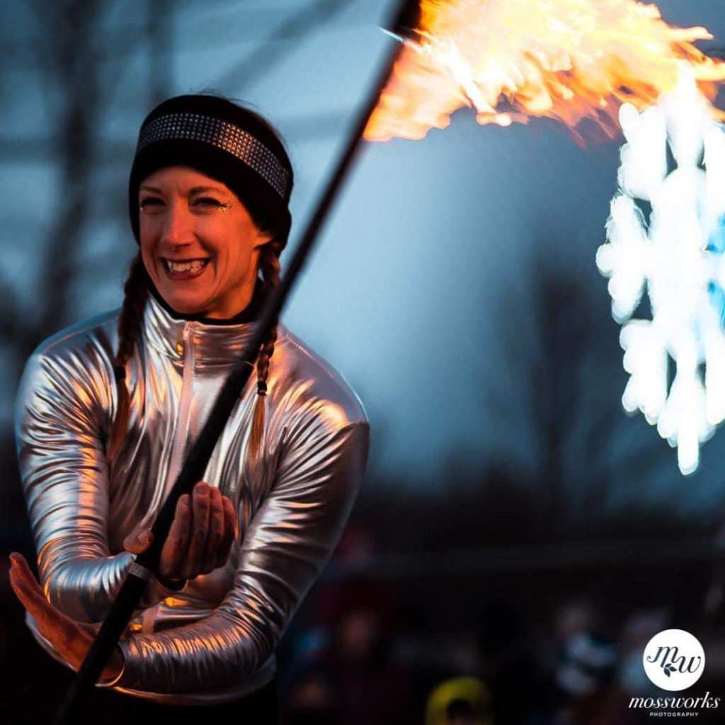 photo of Jennifer Elchuk performing firespinning in winter clothes