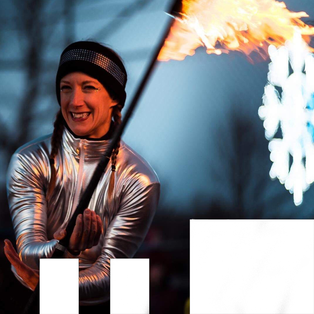 Essential Circus Stage Three photo of Jennifer Elchuk performing firespinning in winter clothes in the photo.