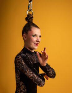 Nicole Malbeuf performing hair suspension