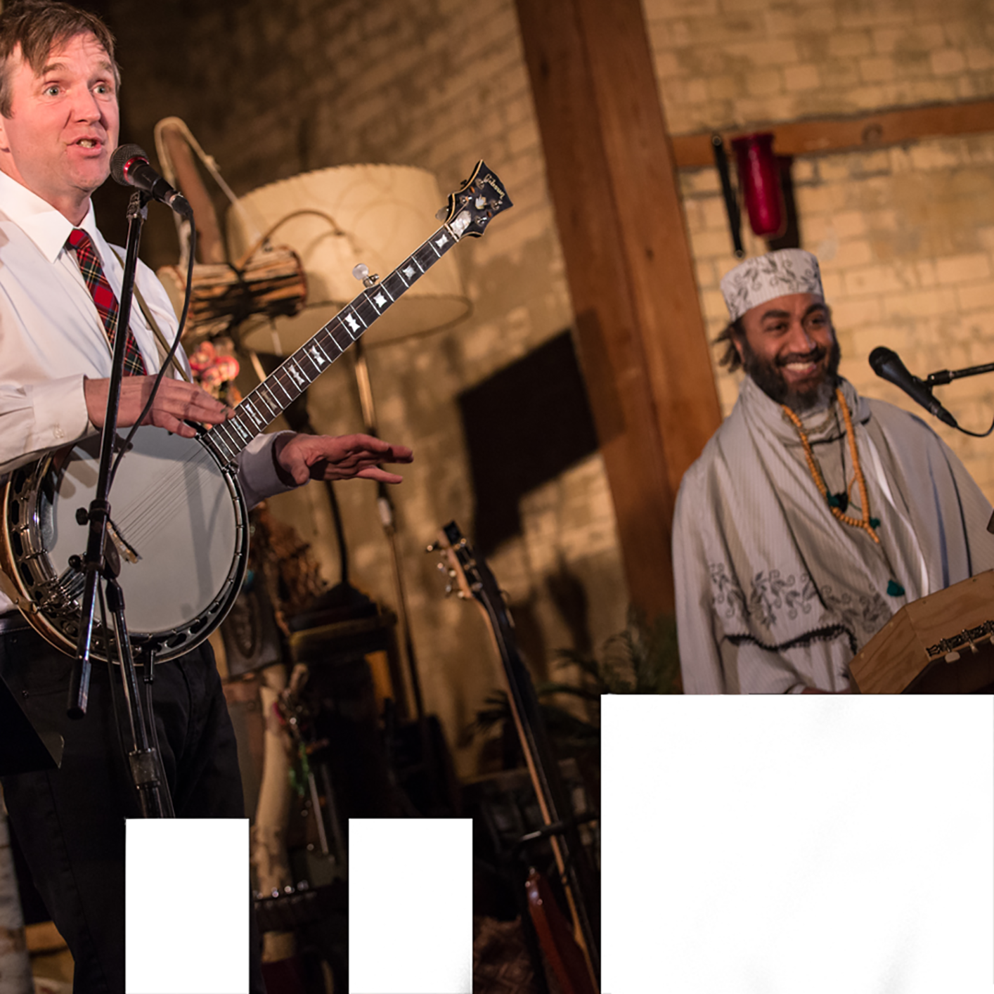 Photo of John Millard and Waleed Abdulhamid performing on stage