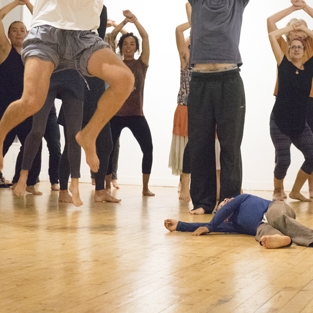Artist Residencies. A group of people dancing in the photo.