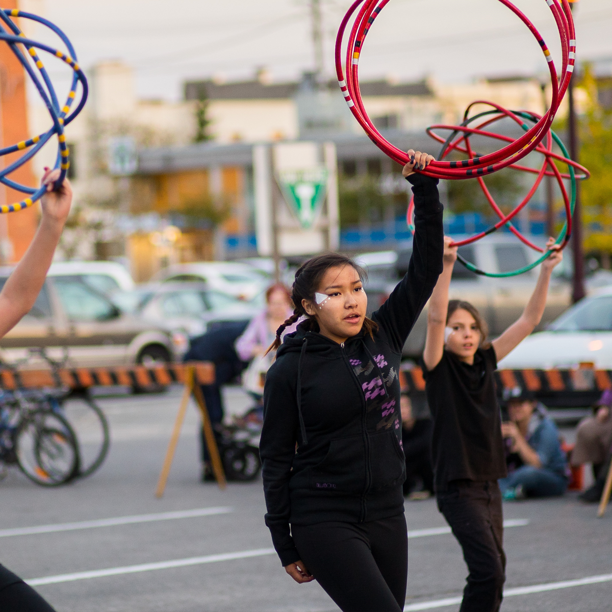 Insites Series. A hoop dance performed by Indigenous youth in the photo.